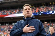 Jan 1, 2017; Denver, CO, USA; Denver Broncos head coach Gary Kubiak during the national anthem before the game against the Oakland Raiders at Sports Authority Field. Mandatory Credit: Ron Chenoy-USA TODAY Sports