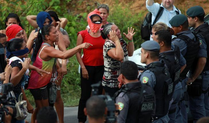Relatives of prisoners react near riot police at a checkpoint close to the prison where around 60 people were killed in a prison riot in the Amazon jungle city of Manaus, Brazil, January 2, 2017. REUTERS/Michael Dantas