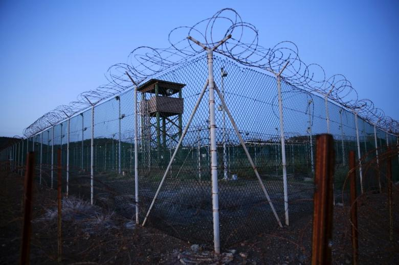 Chain link fence and concertina wire surrounds a deserted guard tower within Joint Task Force Guantanamo's Camp Delta at the U.S. Naval Base in Guantanamo Bay, Cuba March 21, 2016.  REUTERS/Lucas Jackson/File Photo