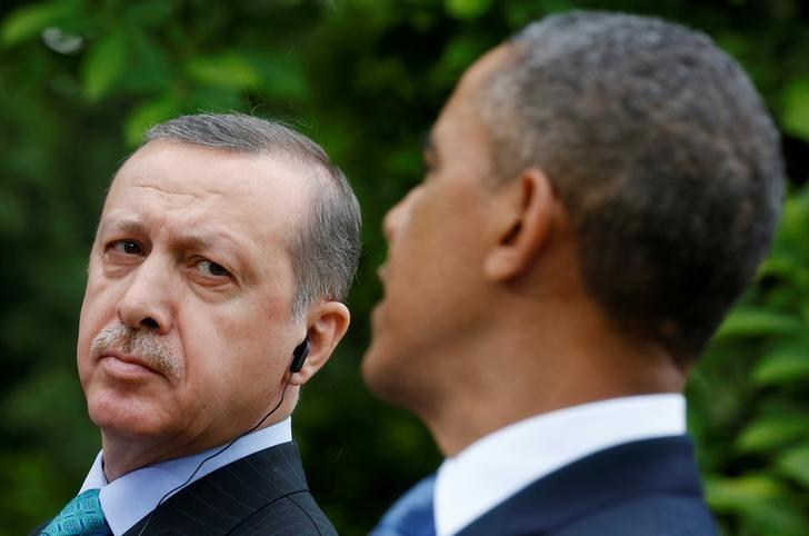 Turkish Prime Minister Recep Tayyip Erdogan (L) listens as U.S. President Barack Obama (R) addresses a joint news conference in the White House Rose Garden in Washington, May 16, 2013.   REUTERS/Kevin Lamarque/File Photo