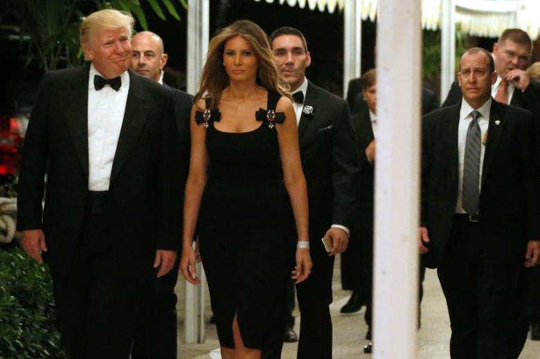 U.S. President-elect Donald Trump and his wife Melania Trump arrive for a New Year's Eve celebration with members and guests at the Mar-a-lago Club in Palm Beach, Florida, U.S. December 31, 2016. REUTERS/Jonathan Ernst