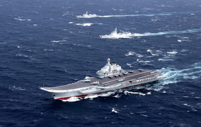 China's Liaoning aircraft carrier with accompanying fleet conducts a drill in an area of South China Sea, in this undated photo taken December, 2016. REUTERS/Stringer