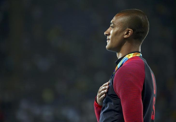 2016 Rio Olympics - Athletics - Victory Ceremony - Men's Decathlon Victory Ceremony - Olympic Stadium - Rio de Janeiro, Brazil - 19/08/2016. Gold medalist Ashton Eaton (USA) of USA reacts on the podium. REUTERS/Gonzalo Fuentes/File Photo