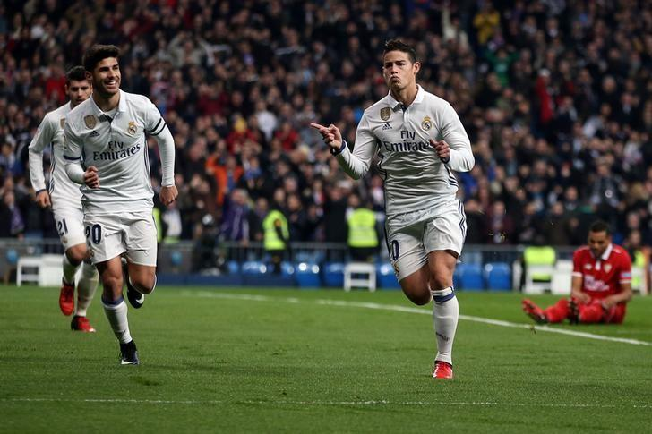 Football Soccer - Real Madrid v Sevilla in King's Cup soccer match- Santiago Bernabeu stadium, Madrid, Spain - 4/1/17 Real Madrid's James Rodriguez celebrates his first goal. REUTERS/Juan Medina