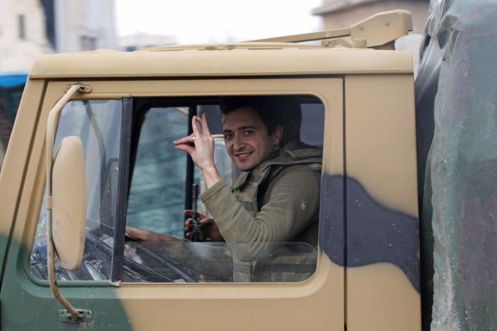 A Turkish soldier gestures inside a military vehicle, part of a convoy driving in the Syrian rebel-held town of al-Rai and heading towards the northern Syrian town of al-Bab, Syria January 4, 2017. REUTERS/Khalil Ashawi