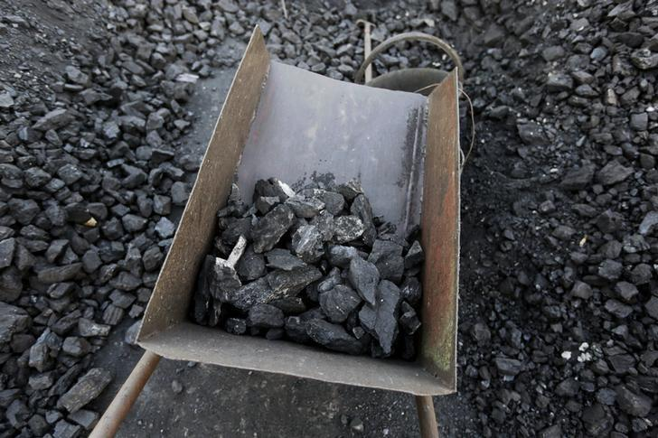 Bad quality coal is picked out at local businessman Sun Meng's small coal depot near a coal mine of the state-owned Longmay Group on the outskirts of Jixi, in Heilongjiang province, China, October 23, 2015. To match story CHINA-COAL/JIXI       Picture taken on October 23, 2015. REUTERS/Jason Lee