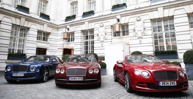 A Bentley Mulsanne Speed, a Bentley Flying Spur, and a Bentley GTC Speed (L-R) are lined up in the courtyard of a hotel in central London January 7, 2015. REUTERS/Andrew Winning