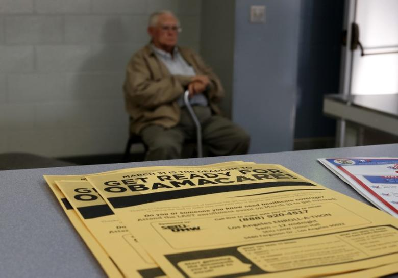 A man sits at a health insurance enrollment event in Cudahy, California March 27, 2014. REUTERS/Lucy Nicholson