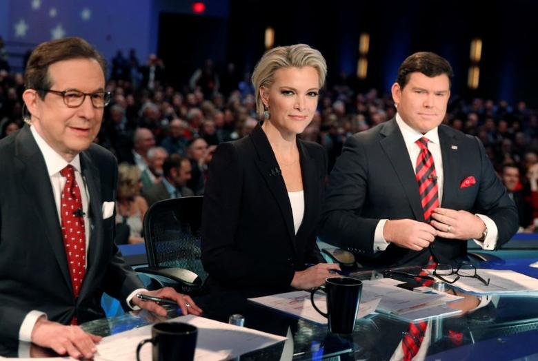 Fox News Channel anchors and debate moderators (L-R) Chris Wallace, Megyn Kelly and Bret Baier await the start of the debate held by Fox News for the top 2016 U.S. Republican presidential candidates in Des Moines, Iowa January 28, 2015. REUTERS/Carlos BarriA/File Photo