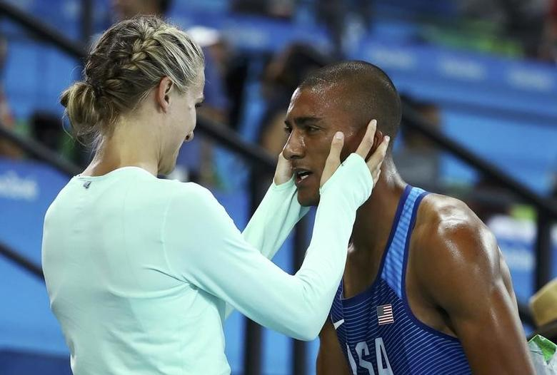 2016 Rio Olympics - Athletics - Final - Men's Decathlon 1500m - Olympic Stadium - Rio de Janeiro, Brazil - 18/08/2016. Ashton Eaton (USA) of USA and his wife Brianne Theisen-Eaton after winning the gold. REUTERS/Lucy Nicholson