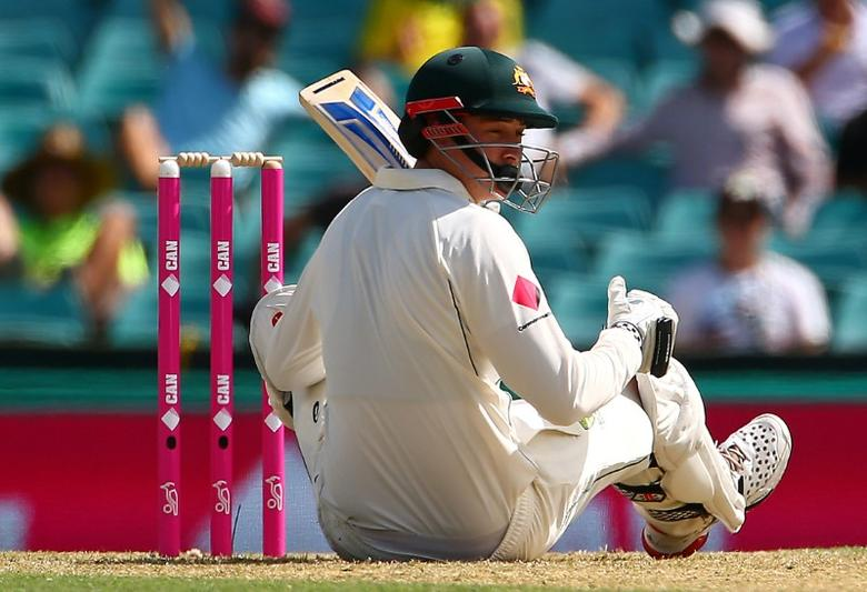 Cricket - Australia v Pakistan - Third Test cricket match - Sydney Cricket Ground, Sydney, Australia - 3/1/17 Australia's Matt Renshaw reacts after being hit on the helmet by a short delivery from Pakistan's Mohammad Amir. REUTERS/David Gray