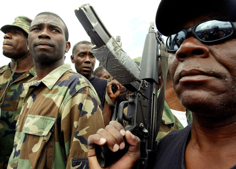 FILE PHOTO --  Guy Philippe, former police chief police, participates in a march into the city of Gonaives, Haiti, February 19, 2004. REUTERS/Daniel Aguilar/File Photo