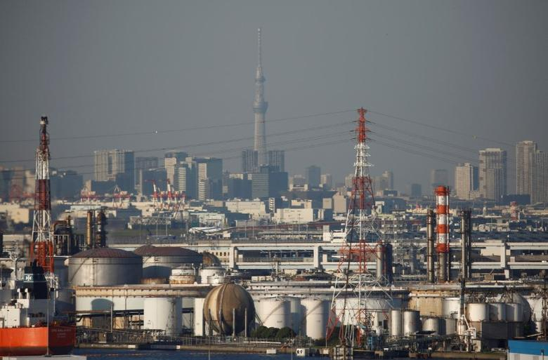 Chimneys of an industrial complex and Tokyo's skyline are seen from an observatory deck at an industrial port in Kawasaki, Japan, October 24, 2016. REUTERS/Kim Kyung-Hoon