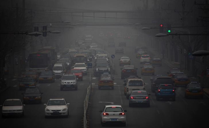 Cars drive along a street in Beijing January 29, 2013. REUTERS/Petar Kujundzic/Files