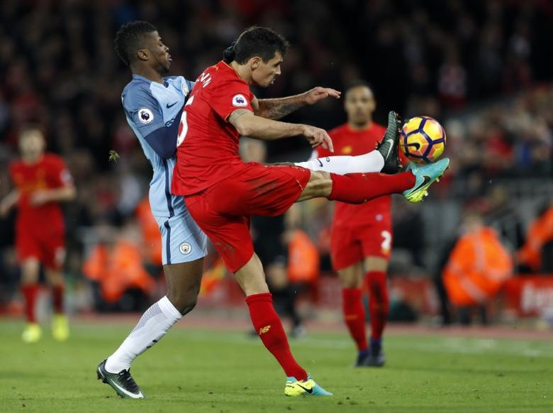 Britain Football Soccer - Liverpool v Manchester City - Premier League - Anfield - 31/12/16 Liverpool's Dejan Lovren in action with Manchester City's Kelechi Iheanacho  Action Images via Reuters / Carl Recine Livepic