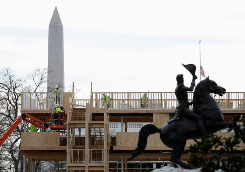 Construction workers build a reviewing stand for the upcoming presidential inauguration near the White House in Washington, U.S., December 11, 2016. REUTERS/Joshua Roberts