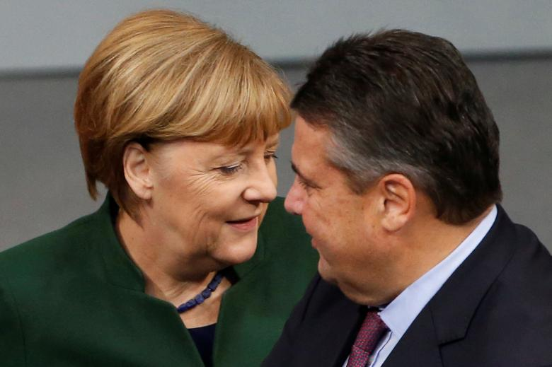 FILE PHOTO - German Chancellor Angela Merkel and Economy Minister Sigmar Gabriel attend a meeting at the lower house of parliament Bundestag on 2017 budget in Berlin, Germany, November 23, 2016. REUTERS/Fabrizio Bensch/File Photo