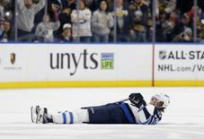 Jan 7, 2017; Buffalo, NY, USA;  Winnipeg Jets right wing Patrik Laine (29) lays on the ice after a check by Buffalo Sabres defenseman Jake McCabe (not pictured) during the third period at KeyBank Center. Mandatory Credit: Timothy T. Ludwig-USA TODAY Sports