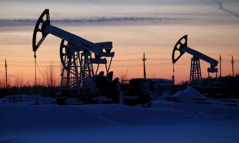 Pump jacks are seen at the Lukoil company owned Imilorskoye oil field outside the west Siberian city of Kogalym, Russia, January 25, 2016. REUTERS/Sergei Karpukhin/File Photo