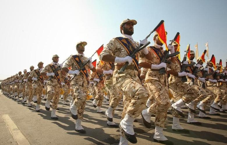 Members of the Iranian revolutionary guard march during a parade to commemorate the anniversary of the Iran-Iraq war (1980-88), in Tehran, Iran, September 22, 2011. REUTERS/Stringer/Files