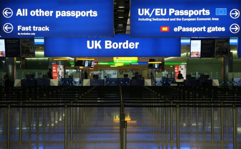 UK Border control is seen in Terminal 2 at Heathrow Airport in London June 4, 2014.   REUTERS/Neil Hall/File Photo