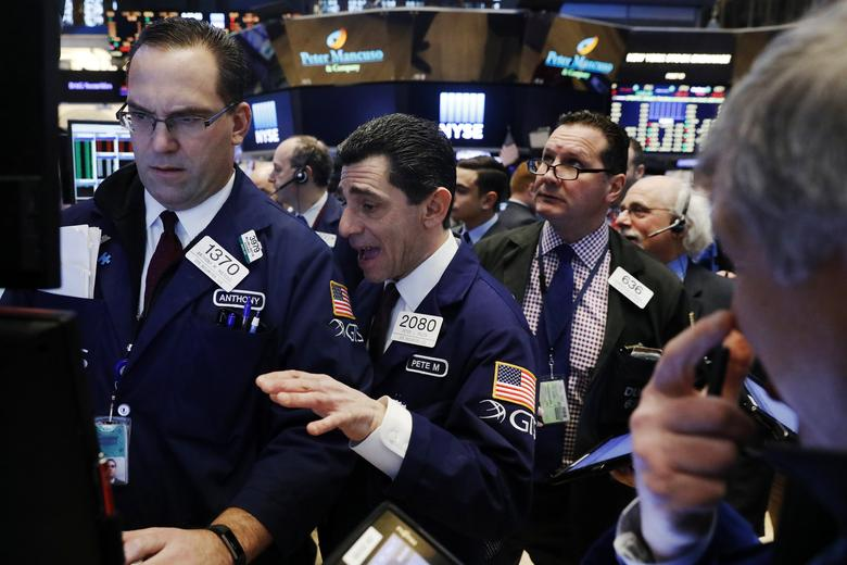 Traders work on the floor of the New York Stock Exchange (NYSE) shortly after the opening bell in New York, U.S., January 9, 2017. REUTERS/Lucas Jackson