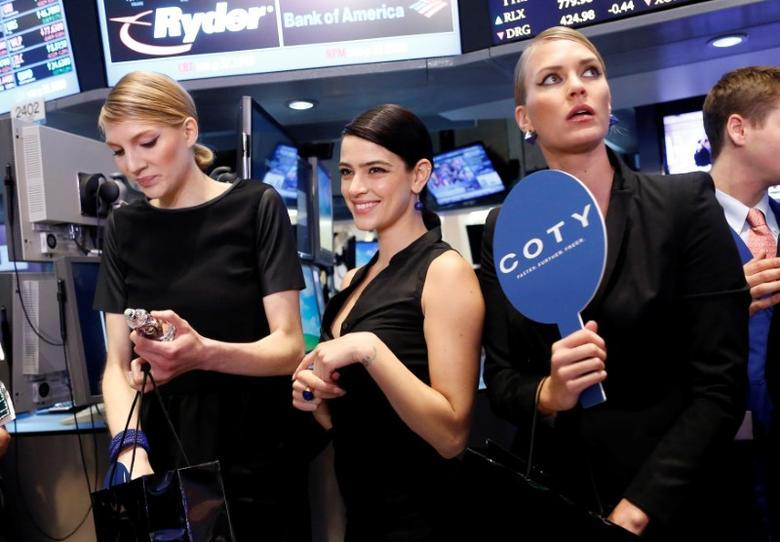 Models gather at a trading post on the floor of the New York Stock Exchange for the IPO of Coty Inc., June 13, 2013.   REUTERS/Brendan McDermid/File Photo