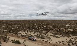 Dakar Rally - 2017 Paraguay-Bolivia-Argentina Dakar rally - 39th Dakar Edition - Seventh stage from Oruro to Uyuni, Bolivia 09/01/17. Sebastien Loeb of France and co-driver Daniel Elena of Monaco drive their Peugeot. REUTERS/Martin Mejia/Pool