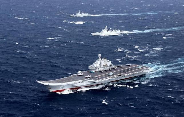 China's Liaoning aircraft carrier with accompanying fleet conducts a drill in an area of South China Sea, in this undated photo taken December, 2016. REUTERS/Stringer/File photo