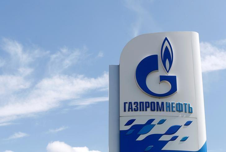 A board with the logo of Gazprom Neft oil company is on display at a fuel station in Moscow, Russia, May 30, 2016. REUTERS/Maxim Zmeyev
