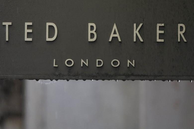 Rain drips off a sign on a Ted Baker sign on a store in London, Britain October 06, 2015. REUTERS/Neil Hall