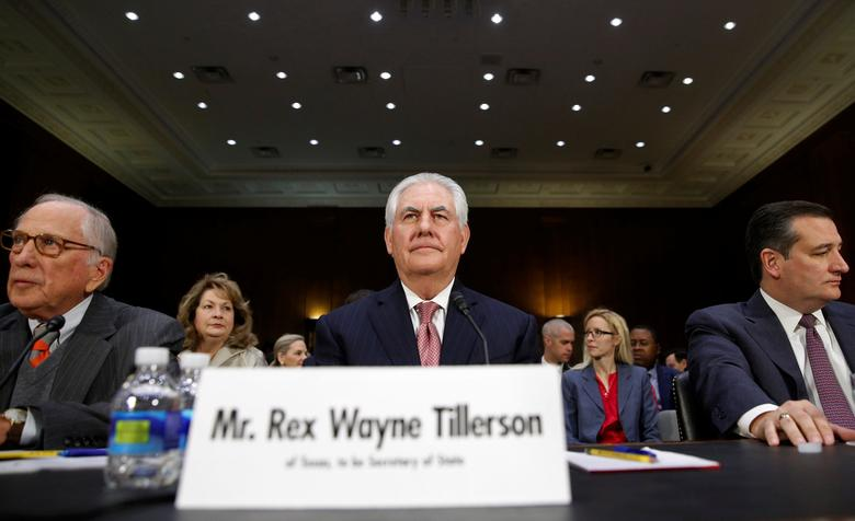 Rex Tillerson (C) takes his seat between former Senator Sam Nunn (L) and Senator Ted Cruz (R), who introduced Tillerson, for his Senate Foreign Relations Committee confirmation hearing to become U.S. Secretary of State on Capitol Hill in Washington, U.S.  January 11, 2017. REUTERS/Kevin Lamarque