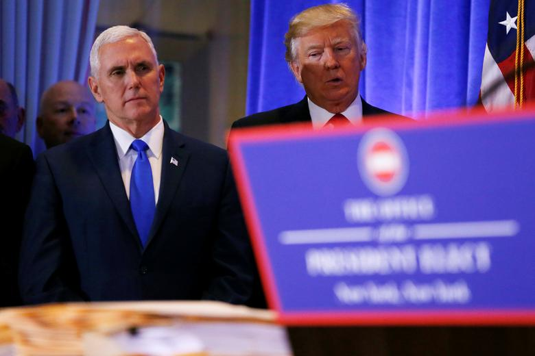 U.S. President-elect Donald Trump stands with Vice President-elect Mike Pence during a press conference in Trump Tower, Manhattan, New York, U.S., January 11, 2017. REUTERS/Shannon Stapleton