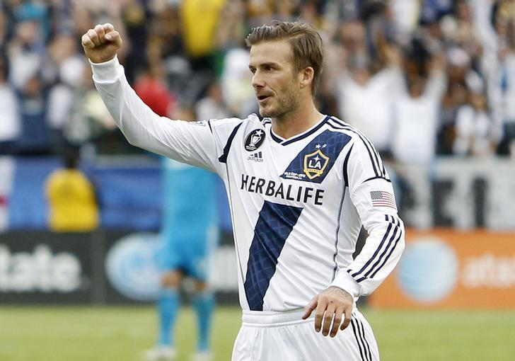 Los Angeles Galaxy's David Beckham celebrates after teammate Omar Gonzalez scored a goal against Houston Dynamo during the second half of the MLS Cup championship soccer game in Carson, California, December 1, 2012. REUTERS/Danny Moloshok