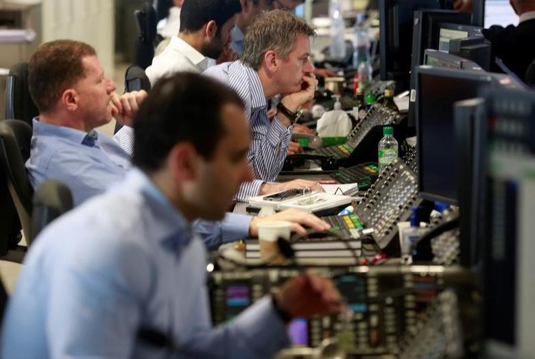 Traders from BGC Partners, a global brokerage company in London's Canary Wharf financial centre wait for European stock markets to open early June 24, 2016 after Britain voted to leave the European Union in the EU BREXIT referendum.       REUTERS/Russell Boyce