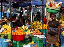 A woman is seen at a market in Luanda,  Angola.  REUTERS/Siphiwe Sibeko