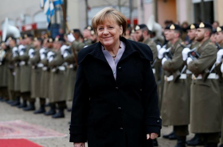 Germany's Chancellor Angela Merkel reviews an honour guard during an official visit to Luxembourg, January 12, 2017.    REUTERS/Francois Lenoir