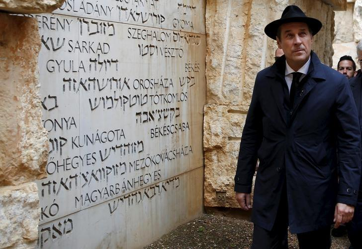 Head of the Austrian Freedom Party (FPOe) Heinz-Christian Strache (L) visits ''The Valley of the Communities'' monument, which bears engravings with the names of some 5,000 Jewish communities destroyed by the Nazis or their collaborators, at Yad Vashem's Holocaust History Museum in Jerusalem, April 12, 2016. REUTERS/Ronen Zvulun/Files