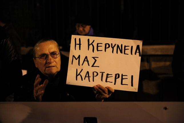 Greek Cypriots protest against the actions of President Nicos Anastasiades during the peace talks, outside the Presidential Palace in Nicosia, Cyprus, January 12, 2017. The placard reads, ''Kerynia is waiting for us''. REUTERS/Yiannis Kourtoglou