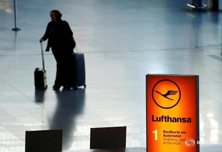 A passenger walks through a terminal during a pilots strike of the German airline Lufthansa at Frankfurt airport, Germany November 29, 2016. REUTERS/Ralph Orlowski - RTSTV41