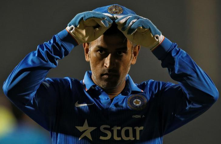 Cricket - India A v England XI- One-day warm-up match - Brabourne stadium, Mumbai, India - 10/01/2017. India A's captain MS Dhoni takes a break during the match. REUTERS/Danish Siddiqui