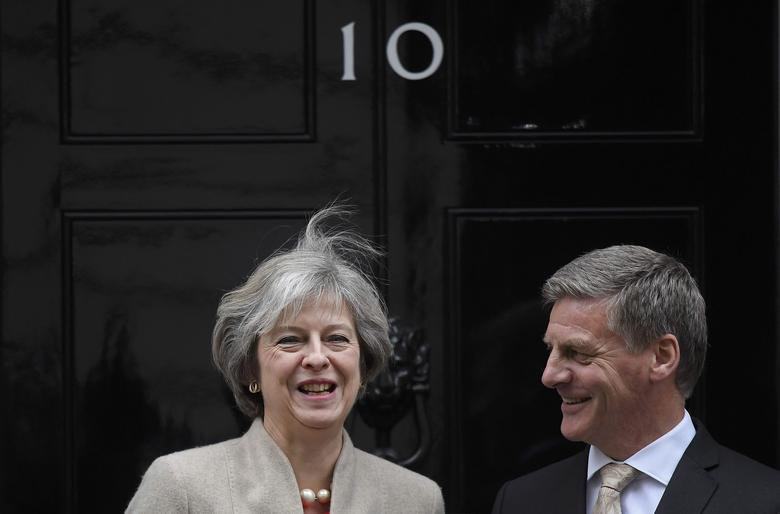 Britain's Prime Minister Theresa May (L) greets her New Zealand counterpart Bill English at Number 10 Downing Street in London, Britain, January 13, 2017. REUTERS/Toby Melville