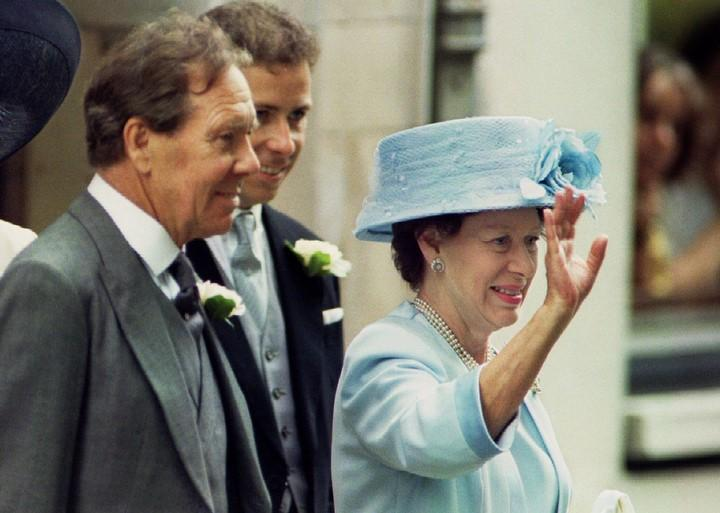 Lord Snowdon stands with his wife Princess Margaret at their daughter's wedding in this July 13, 1994 file photo.  REUTERS/Dylan Martinez/File Photo