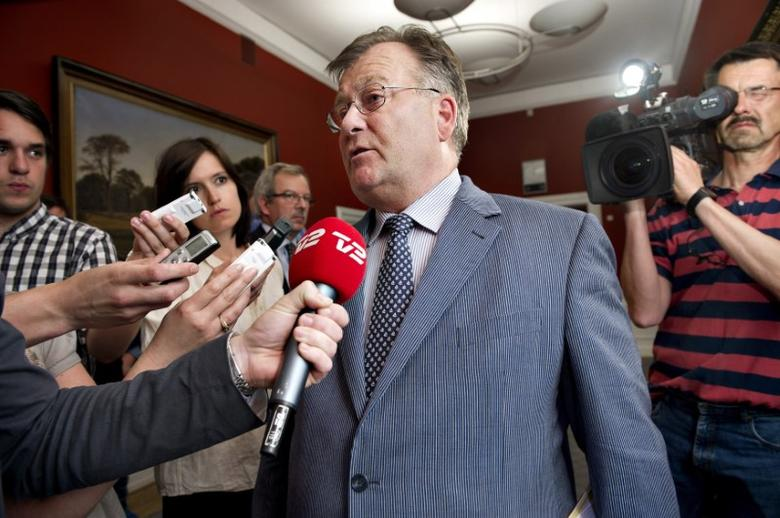 Denmark's Finance Minister Claus Hjort Frederiksen speaks to reporters at after a hearing in the parliamentary financial committee about the custom control agreement at the Christianborg Palace in Copenhagen June 10, 2011.   REUTERS/Marie Hald/Scanpix