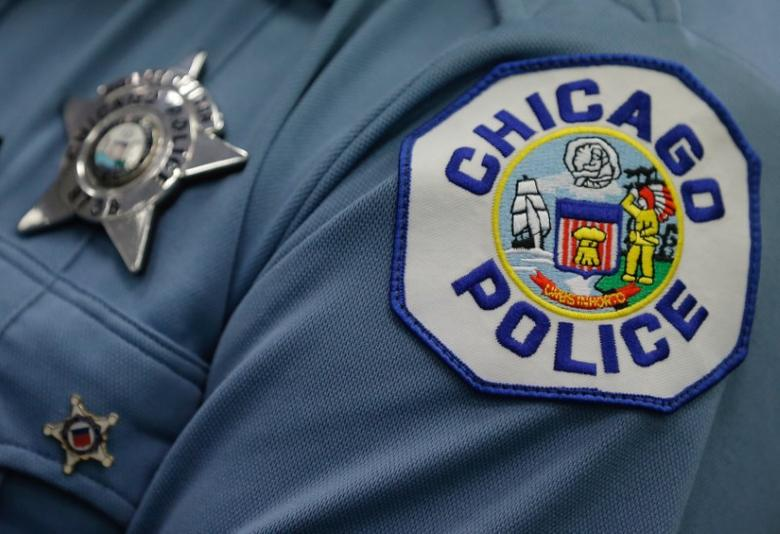 A Chicago police officer attends a news conference announcing the department