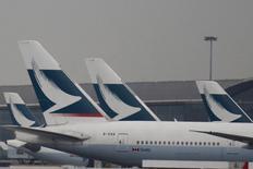 Passenger planes of Cathay Pacific Airways park at the Hong Kong Airport terminal in Hong Kong, China March  7, 2016. REUTERS/Bobby Yip/File Photo