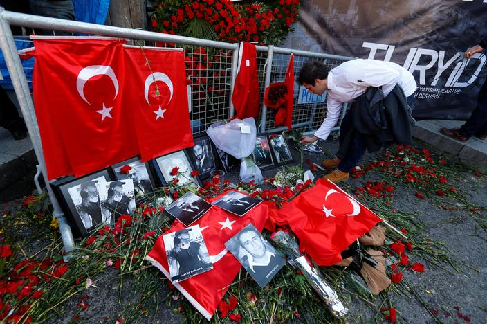 A man places flowers at the entrance of Reina nightclub, which was attacked by a gunman, in Istanbul, Turkey January 3, 2017. REUTERS/Murad Sezer/File Photo