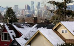 Rooftops of houses and the downtown core are seen in Vancouver, British Columbia, Canada January 7, 2017.  REUTERS/Chris Helgren