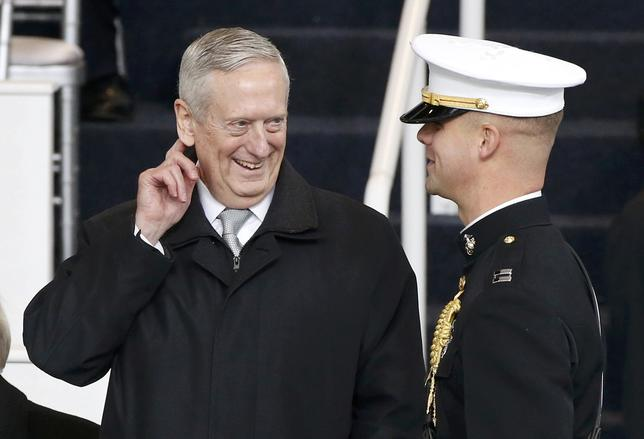 Retired U.S. Marine Corps General and defense secretary-nominee James Mattis speaks with a Marine guard before the Inaugural parade in Washington, January 20, 2017.  REUTERS/Lucas Jackson
