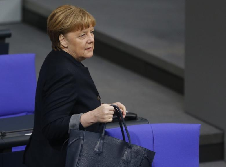 German Chancellor Angela Merkel walks in the Lower house of parliament Bundestag before a ceremony to commemorate victims of the Berlin truck attack in Berlin, Germany, January 19, 2017. REUTERS/Hannibal Hanschke